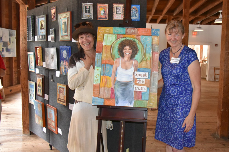 Suesan Stovall and Elizabeth R. Whelan with portrait of Suesan at Artists in Art